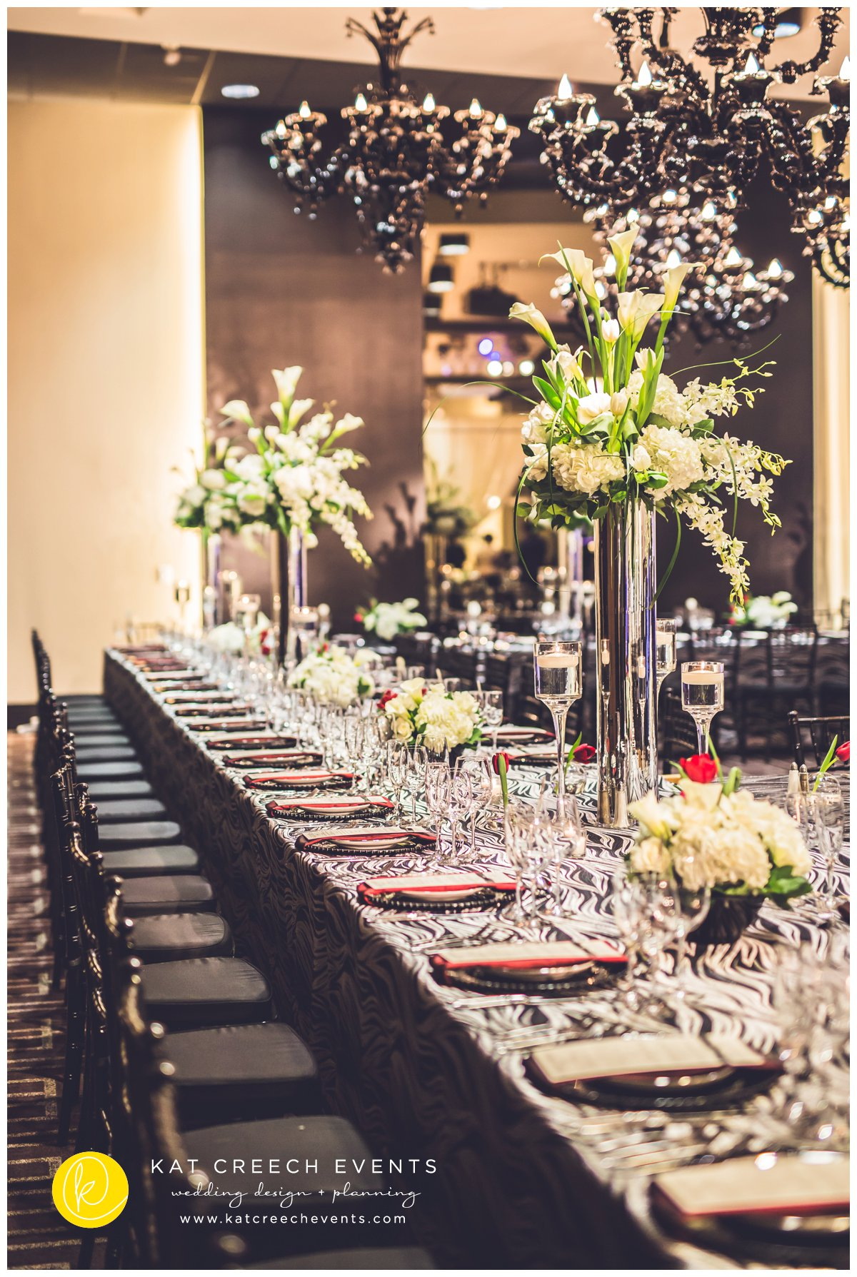 black and silver linens | black glass beaded charger | tall modern centerpieces | ivory floral
