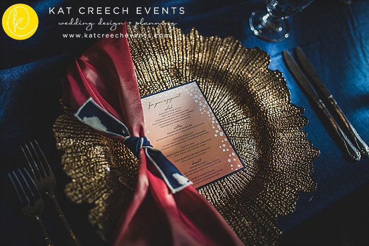gold leaf charger | navy and coral wedding | unique wedding napkin design | wedding stylist | Kat Creech Events