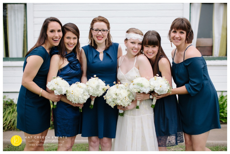 assorted navy bridesmaid dresses